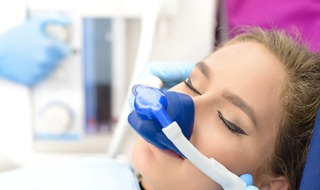 woman eyes closed receiving nitrous oxide