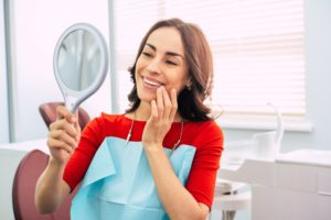 woman looking pleased with dental work