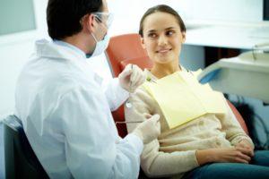 patient speaking with dentist