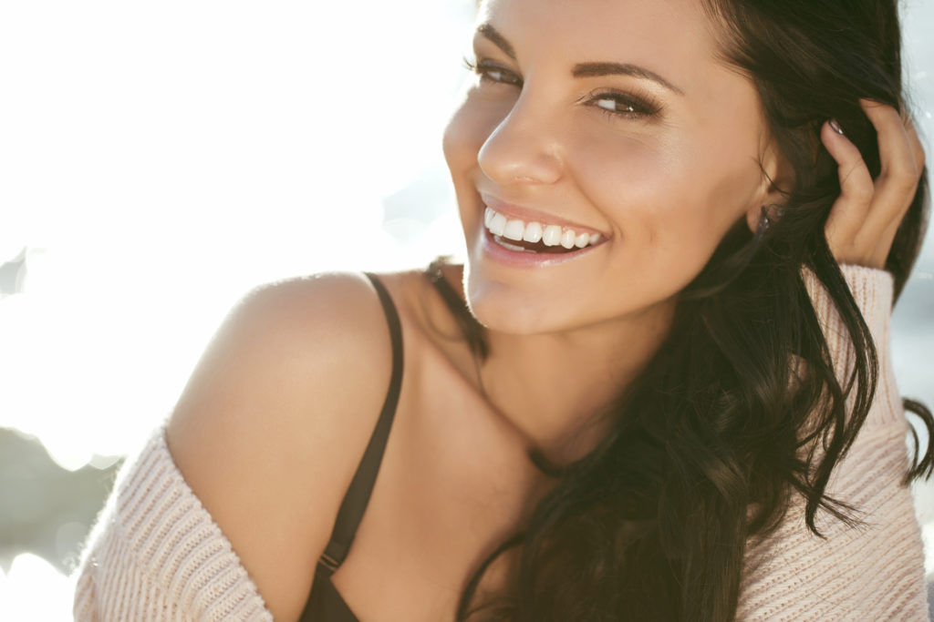 Woman smiling with white, straight teeth