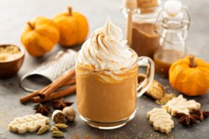 Closeup of seasonal hot drinks next to other fall foods
